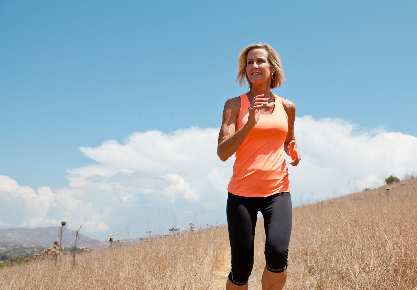 Woman with strong pelvic floor running through field