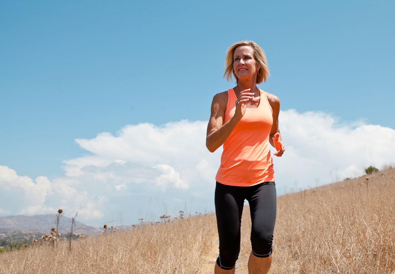 Woman with strong pelvic floor running through field